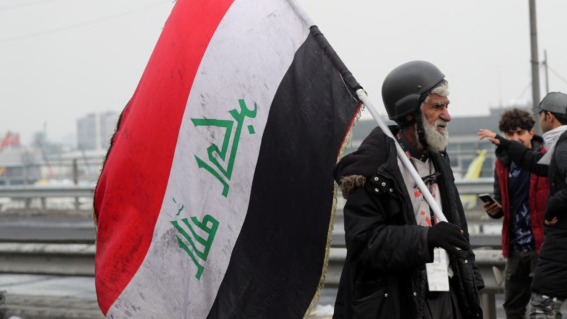 An Iraqi demonstrator holds an Iraqi flag during ongoing anti-government protests in Baghdad, Iraq January 23, 2020. (Reuters)