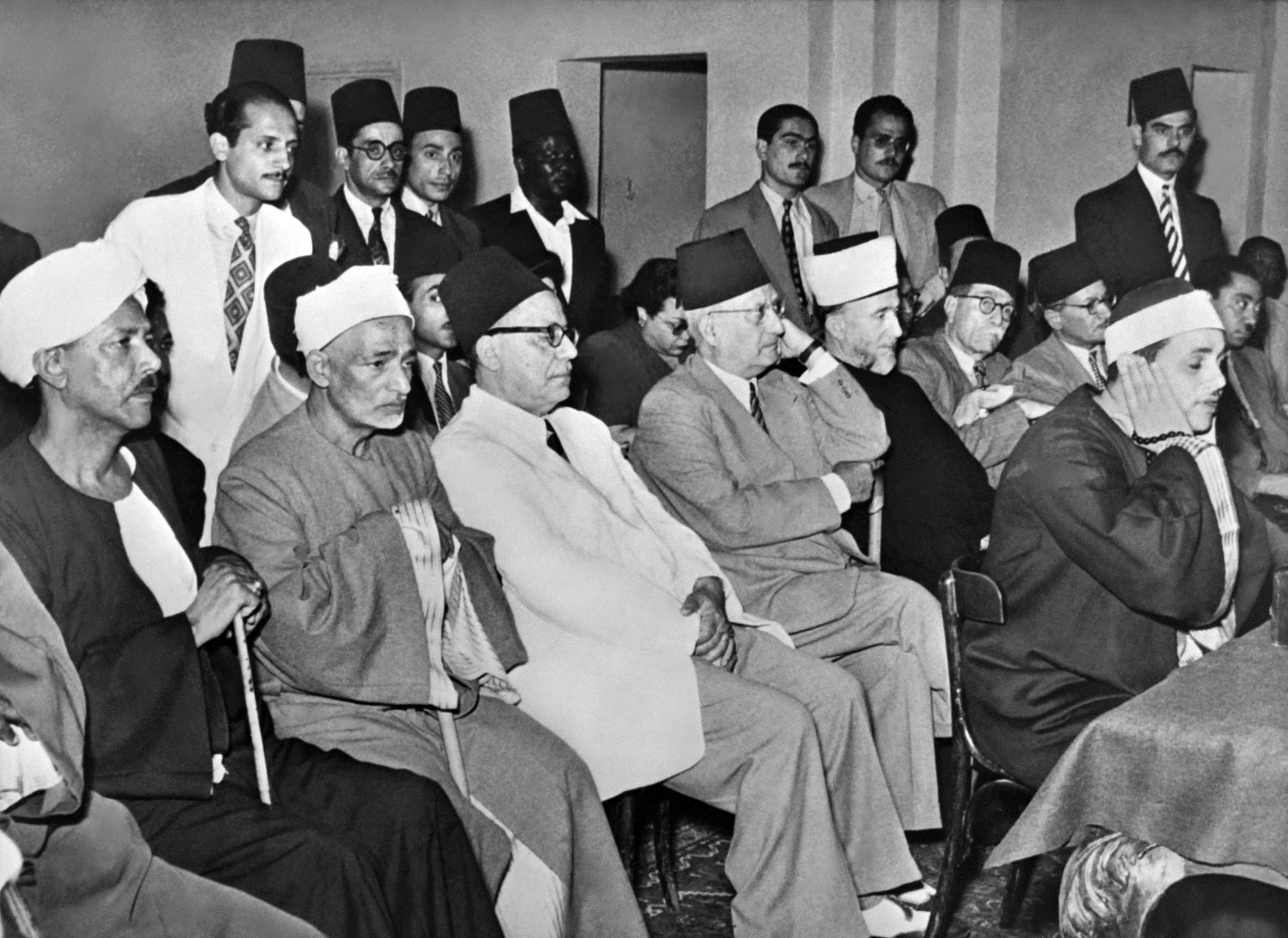 Former Grand Mufti of Palestine Mohammad Amin Al-Husseini (5-L, beard, white fez, dark robe) and leader of Egyptian National Party Hafiz Ramadan Pasha (4-L) attend a meeting of political parties delegates in Egypt in circa October 1951. (AFP)