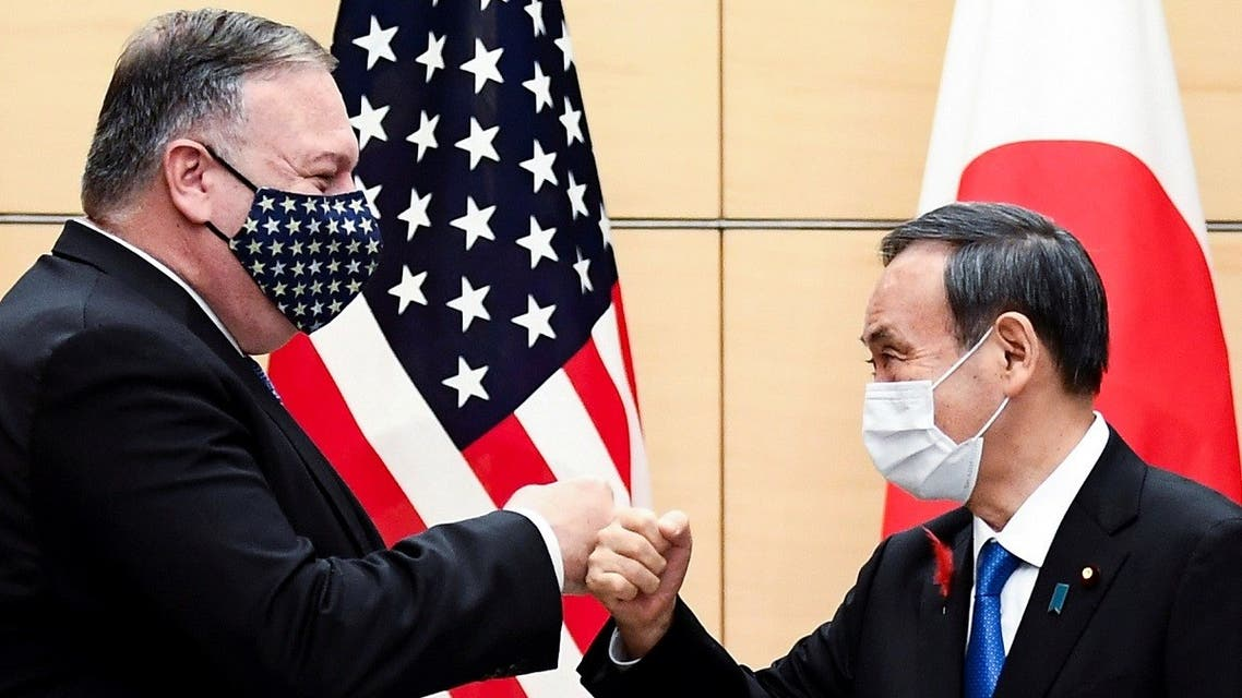 Japan's Prime Minister Yoshihide Suga and US Secretary of State Mike Pompeo greet prior to their meeting at the prime minister's office in Tokyo, Japan, on October 6, 2020. (Reuters)