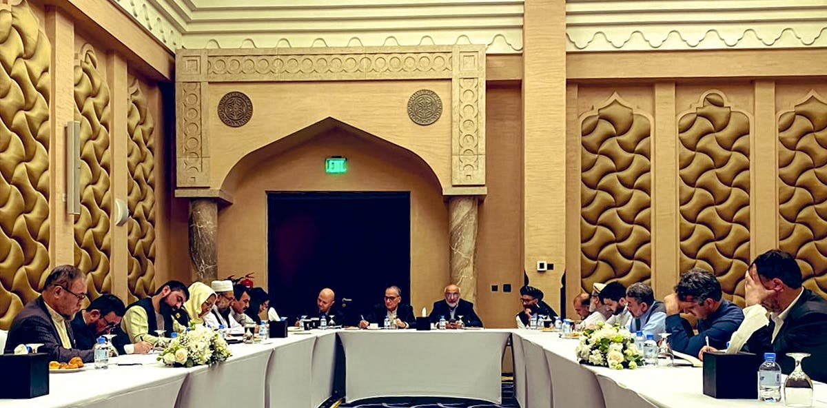Negotiators from the government of Afghanistan prepare before their meeting with representatives of the Taliban (unseen) in Qatar's capital Doha. (File photo: AFP)