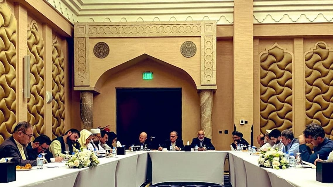 In this file photo provided on September 15, 2020, negotiators from the government of Afghanistan prepare before their meeting with representatives of the Taliban (unseen) in Qatar's capital Doha. (Afghanistan Peace Negotiation Team/AFP)
