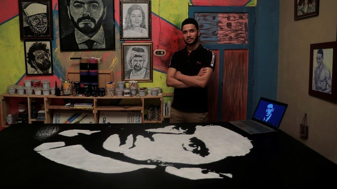 Egyptian artist Hany Genedy poses for a photograph next to pictures made with salt in a gallery room at his home in Hihya city, north of Cairo, Egypt, September 9, 2020. (Reuters)