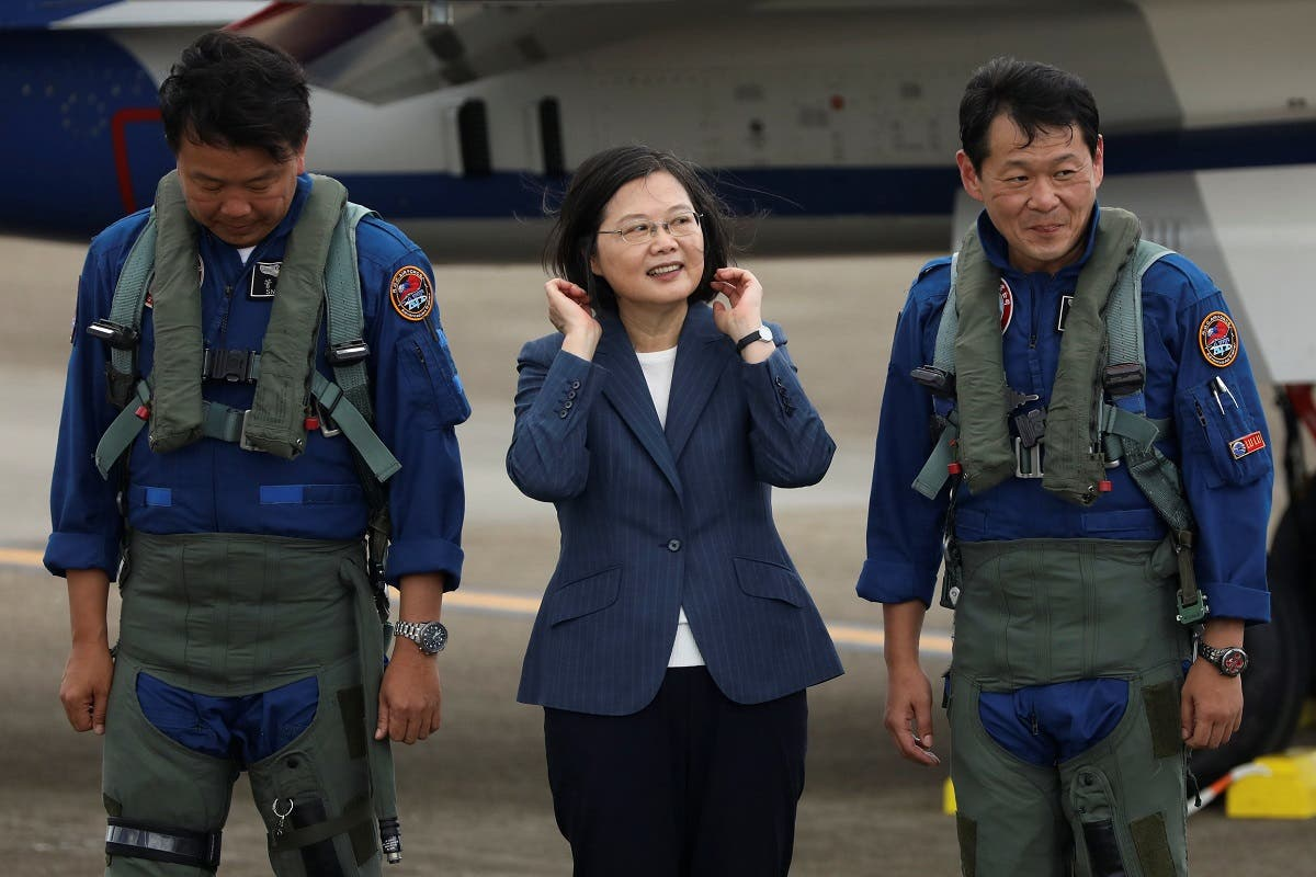 Taiwanese President Tsai Ing-Wen prepare to take photos with the pilots of AIDC T-5 Brave Eagle, Taiwan's first locally manufactured advanced jet trainer, in Taichung, Taiwan. (Reuters)