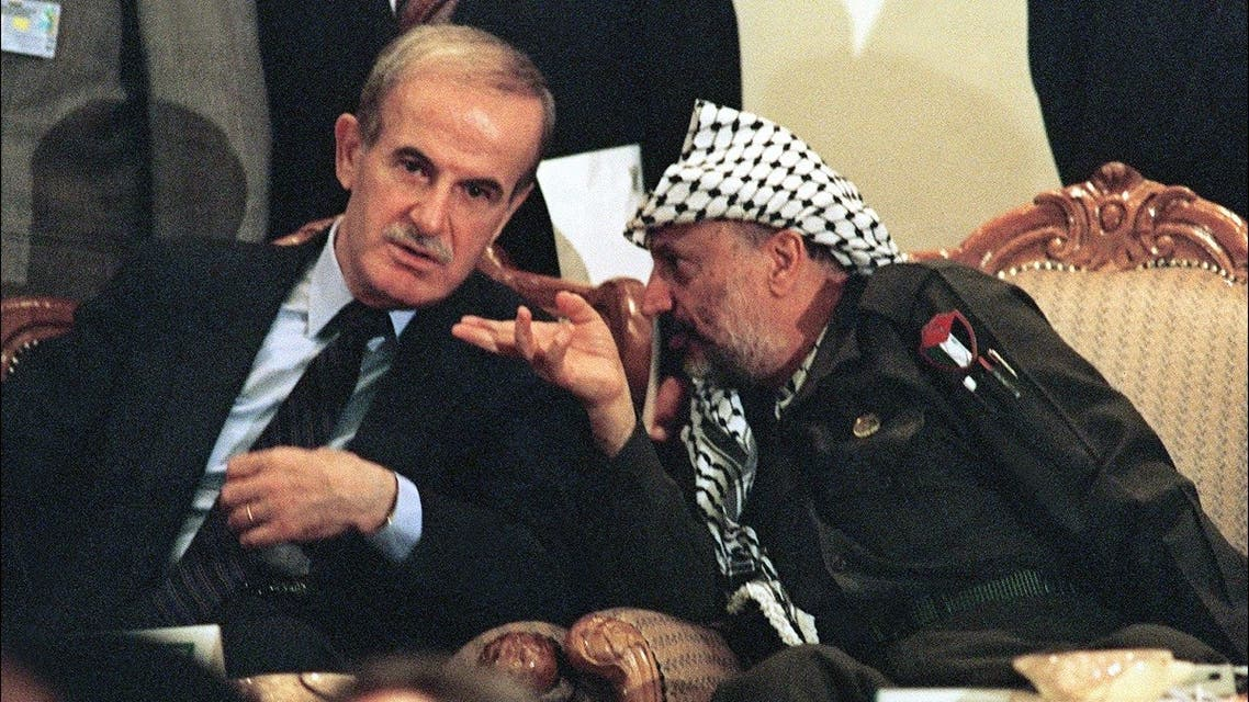 Yasser Arafat (R), chairman of Palestine Liberation OrganisAtion (PLO) shown in file picture dated 01 September 1989. (AFP)