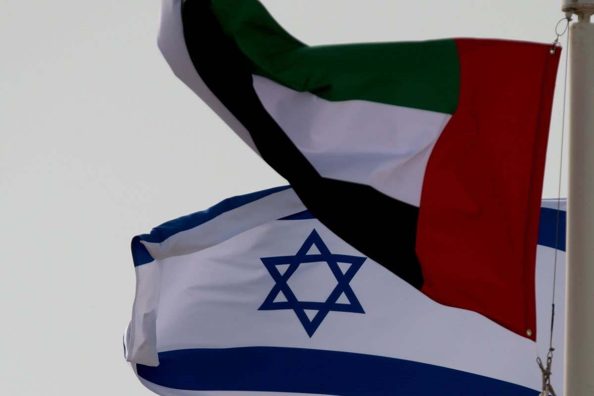 The flags of UAE and Israel fly upon the arrival of Israeli and US delegates at Abu Dhabi International Airport, in Abu Dhabi, United Arab Emirates August 31, 2020. (File photo: Reuters)