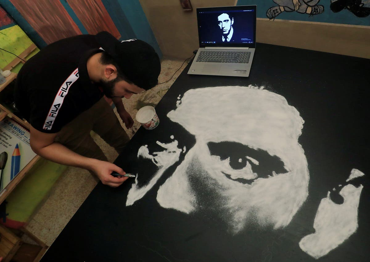 Egyptian artist Hany Genedy creates a picture of Al Pacino made with salt. (Reuters)