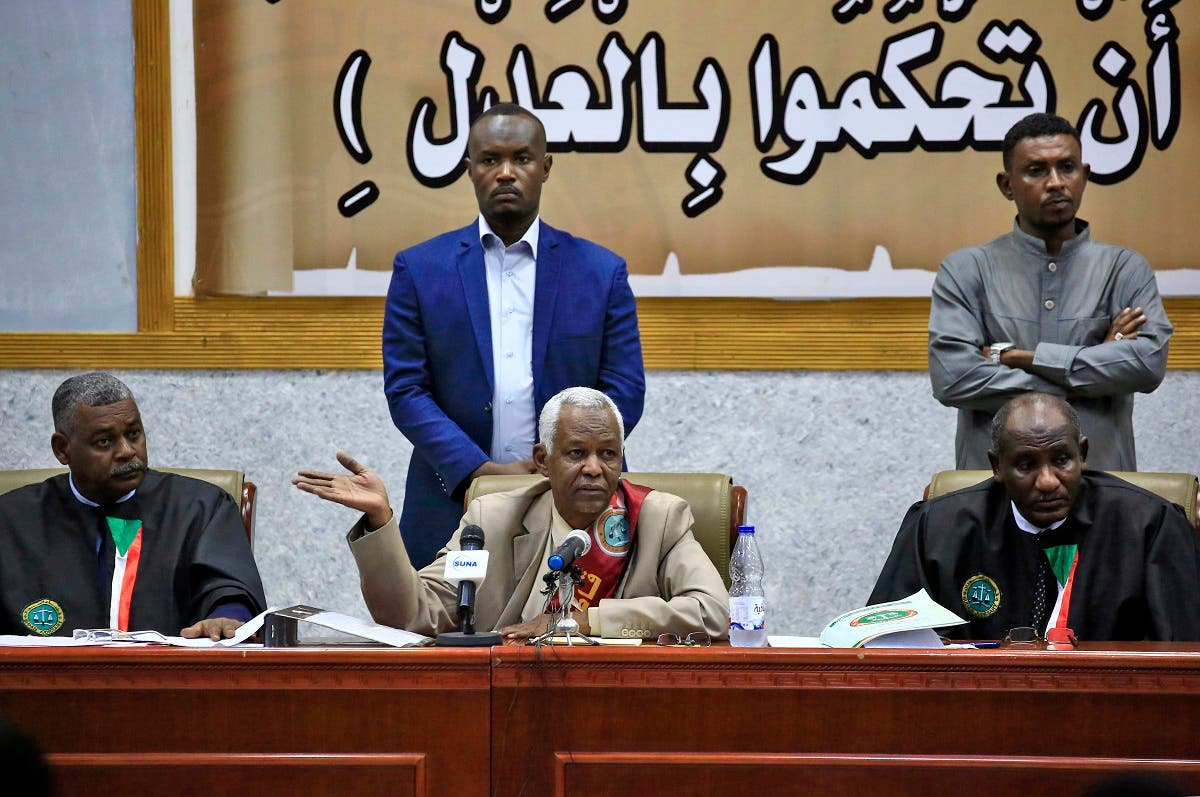 The presiding judge Issam al-Din Mohammad Ibrahim (C) speaks during a hearing in the trial of al-Bashir (unseen) and 27 co-accused over the 1989 military coup, in Khartoum, on October 6, 2020. (AFP)