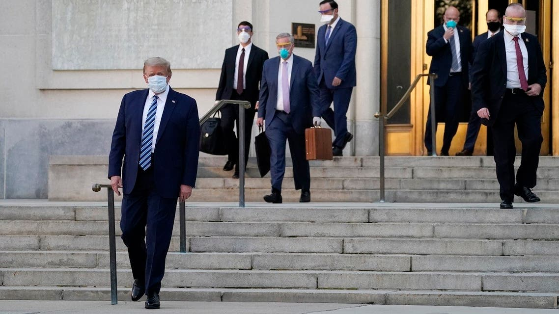 President Donald Trump walks out of Walter Reed National Military Medical Center after receiving treatments for coronavirus, , Oct. 5, 2020. (AP)