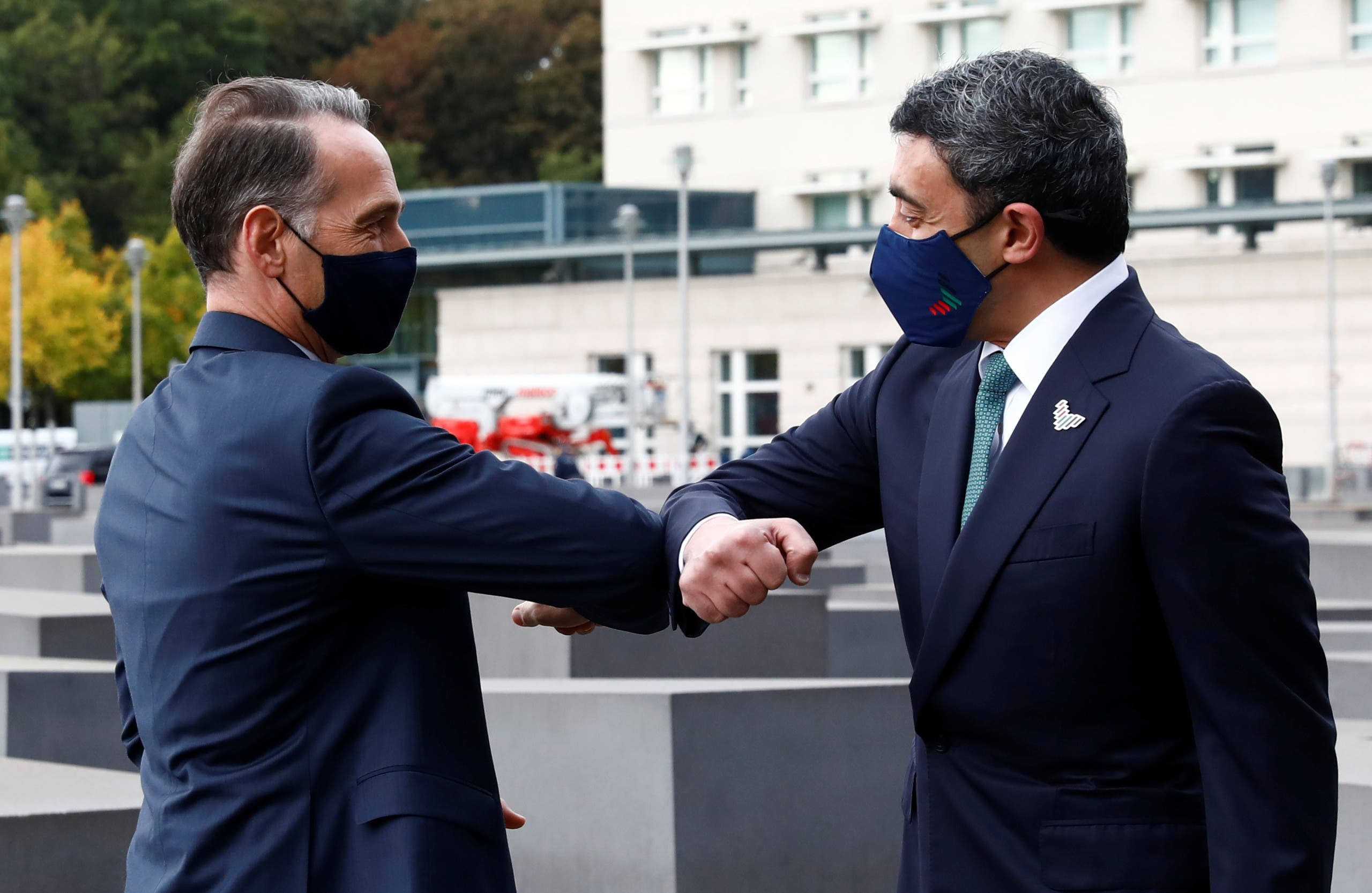 UAE Foreign Minister Sheikh Abdullah bin Zayed al-Nahyan greets German Foreign Minister Heiko Maas as he and his Israeli counterpart Gabi Ashkenazi visit the Holocaust memorial together prior to their historic meeting in Berlin, Germany October 6, 2020. (Reuters)