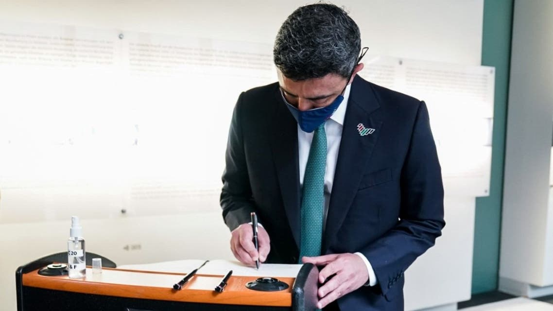 UAE's Minister of Foreign Affairs Sheikh Abdullah bin Zayed writes in the visitors' book at the Memorial to the Murdered Jews of Europe memorial in Berlin, Germany, on October 6. (WAM)