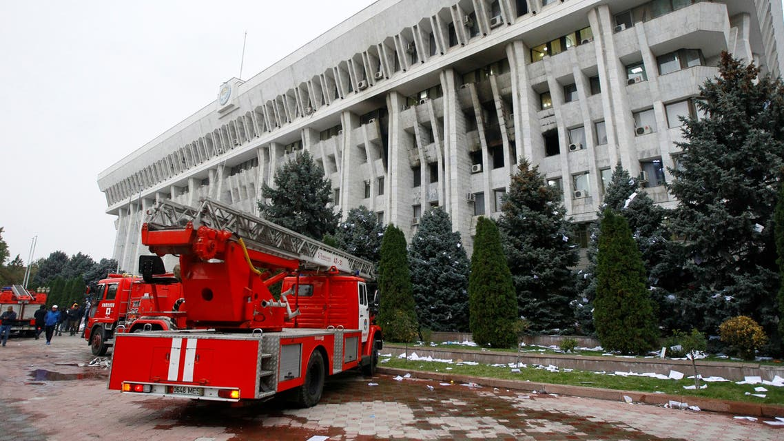 Fire brigade trucks are seen in front of the government headquarters which has been taken over by protesters against the results of a parliamentary election in Bishkek, Kyrgyzstan, October 6, 2020. (Reuters)