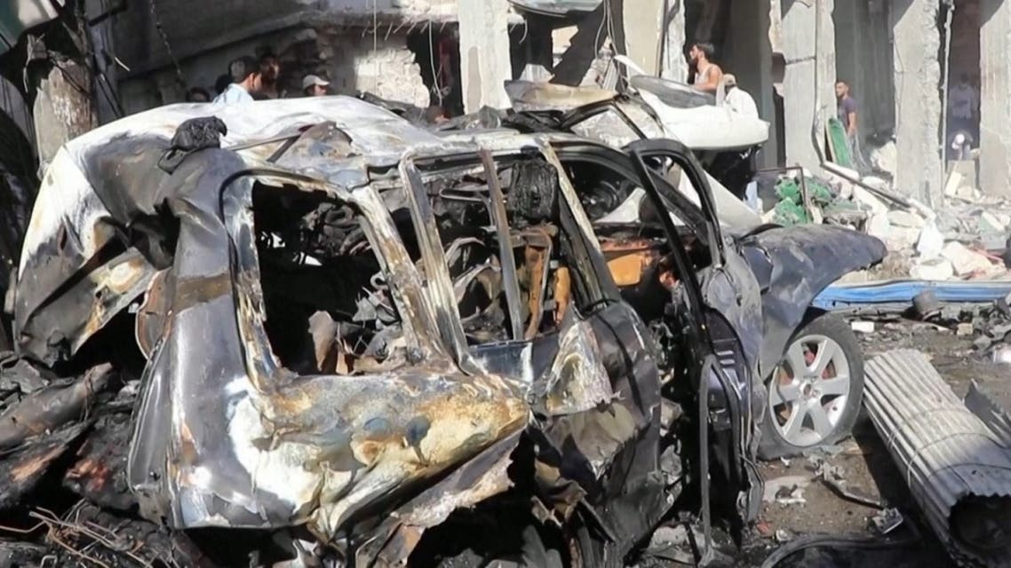 A screengrab shows a damaged car and buildings from the explosion which targeted the town of al-Bab in northwest Syria, on October 6, 2020. (Reuters)