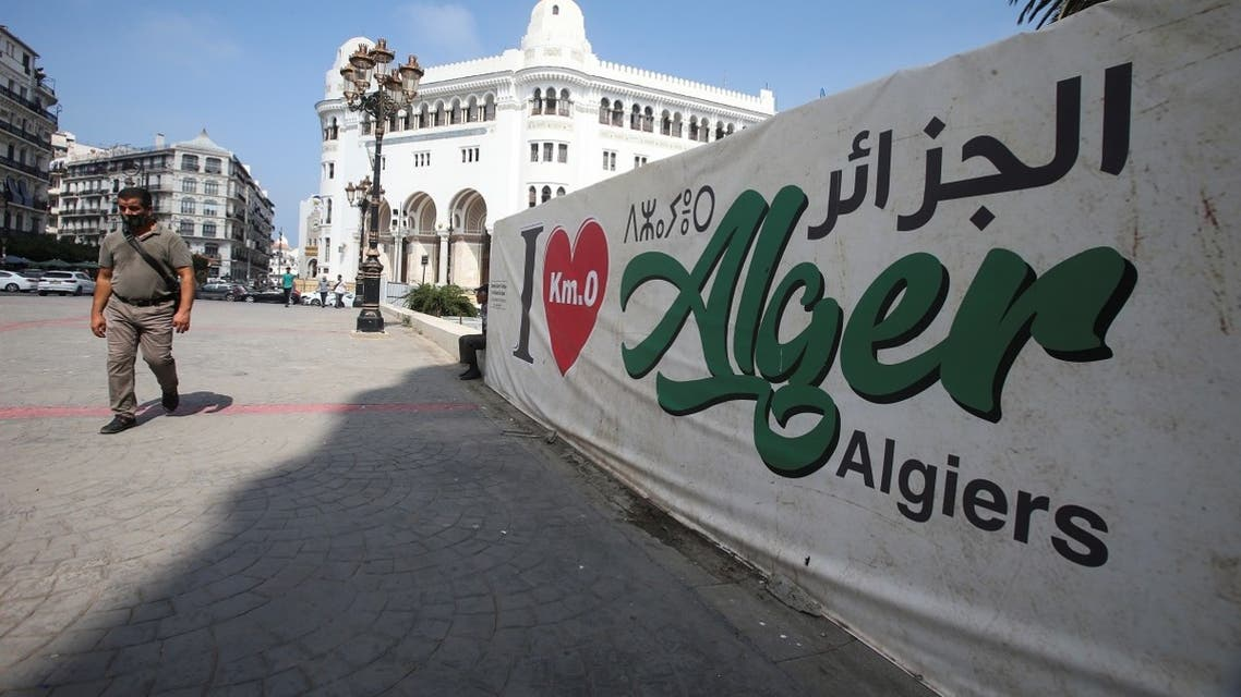 """A man walks past an """"I love Algiers"""" banner near the central post office in Algiers, Algeria September 16, 2020. Picture taken September 16, 2020. (Reuters)"""