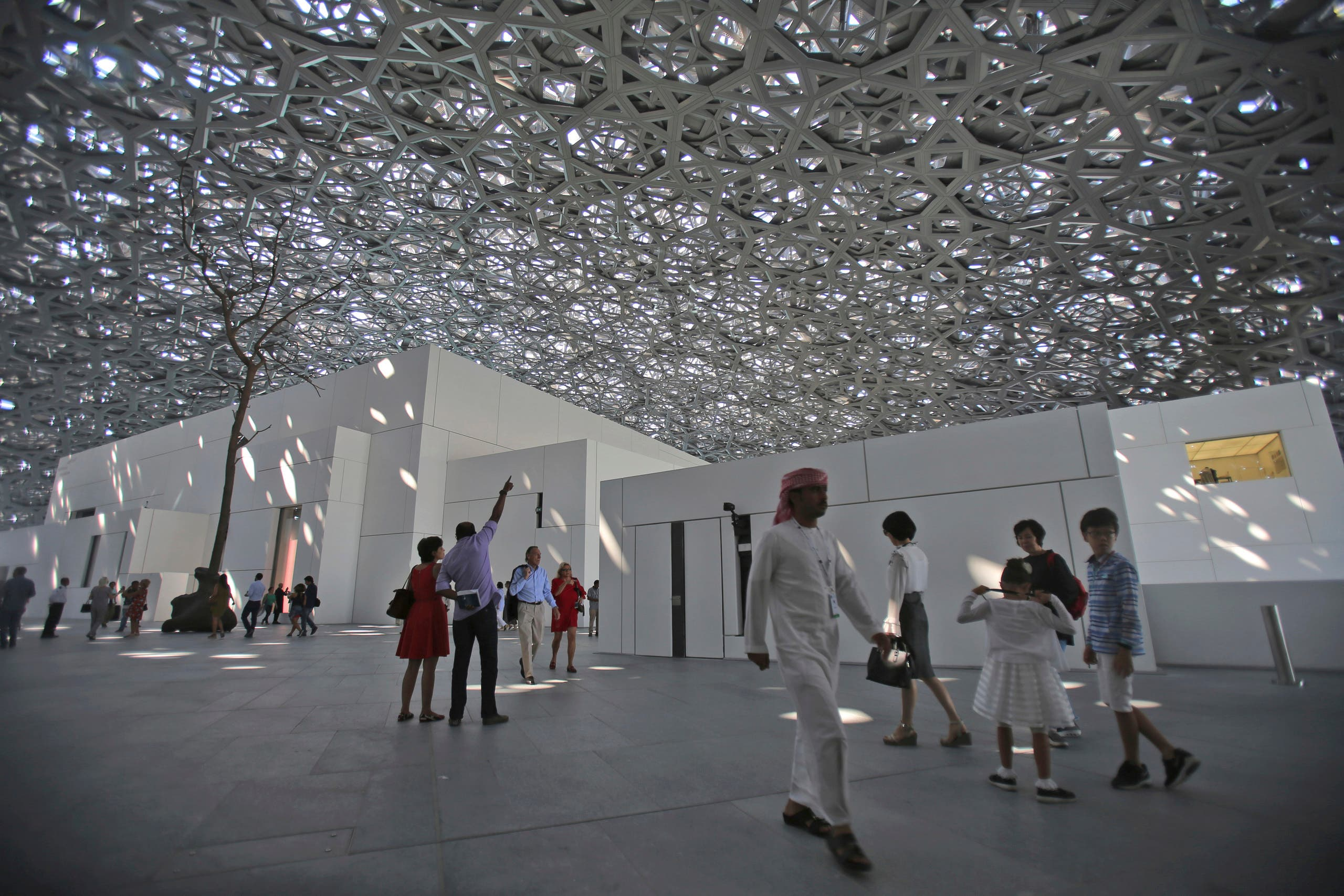 People visit the Louvre Museum during the public opening day, in Abu Dhabi, United Arab Emirates, Saturday, Nov. 11, 2017. (AP)