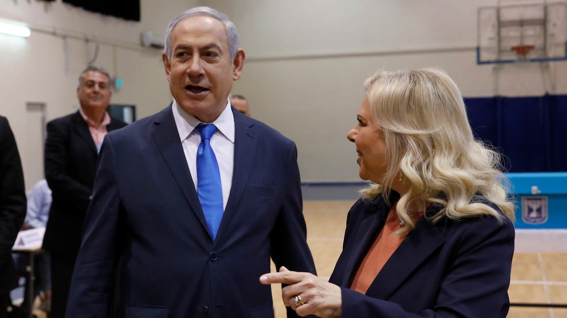 Israeli Prime Minister Benjamin Netanyahu and his wife Sara Netanyahu pause before casting their ballots during the Israeli legislative elections at a polling station in Jerusalem, Monday, March 2, 2020. (File photo: AP)