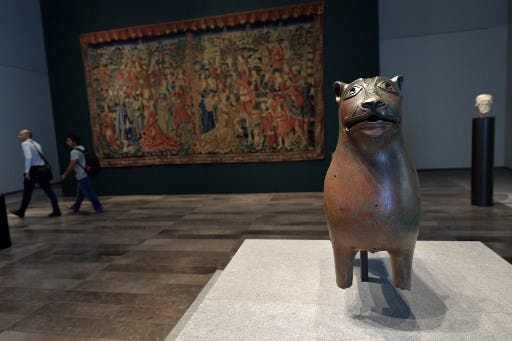 An ancient bronze statue titled Lion de Mari-cha is seen on display at the Louvre Abu Dhabi Museum during a media tour on November 6, 2017.  (AFP)