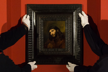 Staff at Louvre Abu Dhabi install the museum's new acquisition, Rembrandt's Head of a Young Man. (Courtesy: Louvre Abu Dhabi)