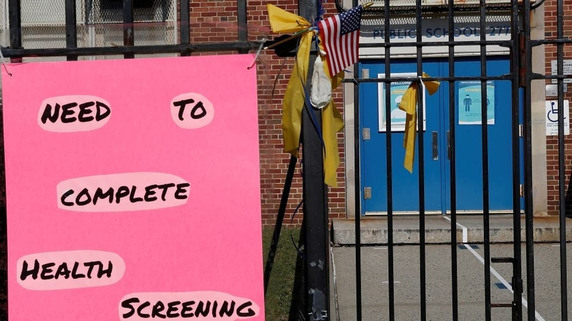 A sign is posted on the fence of P.S. 277 amid the coronavirus outbreak, in Brooklyn, New York, Oct. 6, 2020. (Reuters)