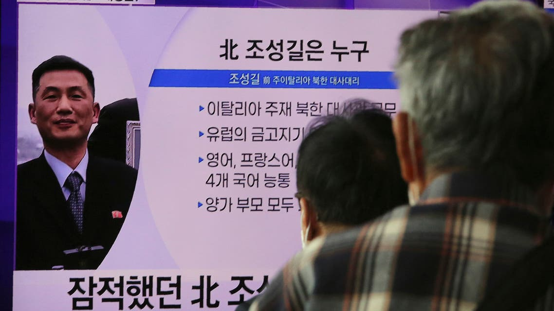People watch a TV showing an image of Jo Song Gil, the North Korea's former ambassador to Italy, during a news program at the Seoul Railway Station in Seoul, South Korea, Wednesday, Oct. 7, 2020. (AP)