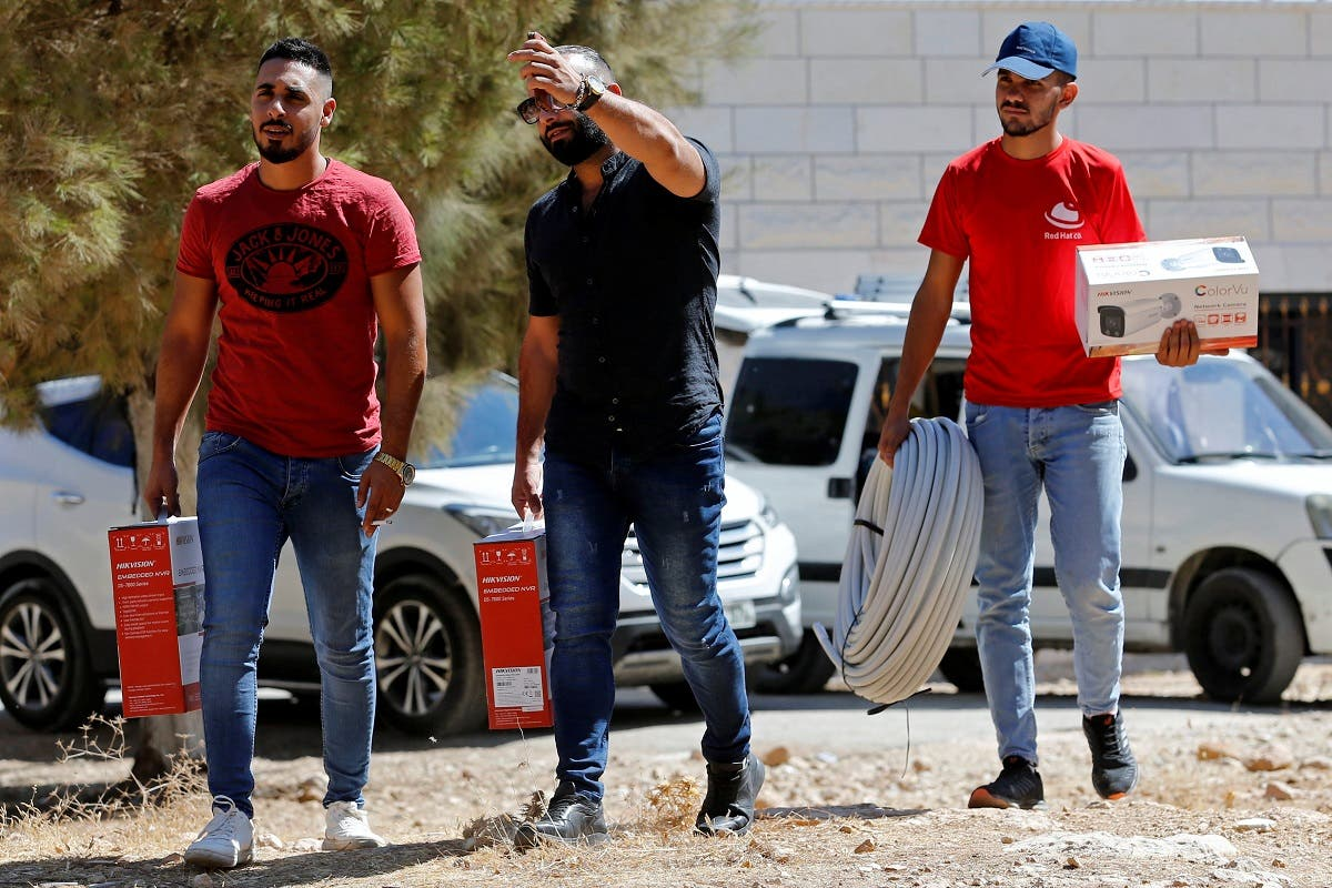 Workers arrive to install a video surveillance system to keep an eye on nearby Israeli settlers who Palestinians accuse of frequent attacks, in the village of Kisan in the occupied West Bank October 6, 2020. (Reuters/Mussa Qawasma)