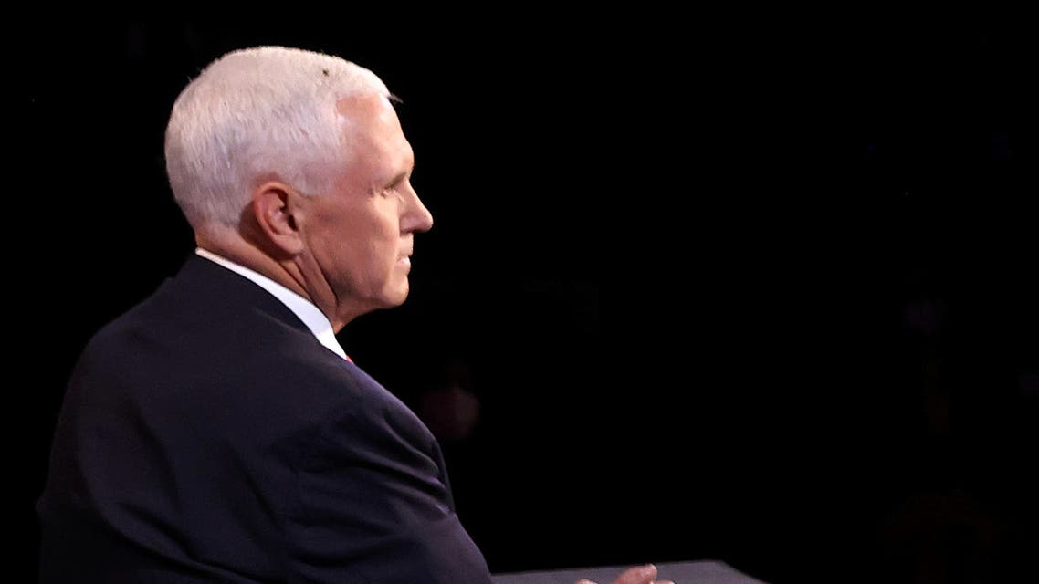 A fly lands on Vice President Mike Pence's head during the VP debate against Kamala Harris. (Reuters)