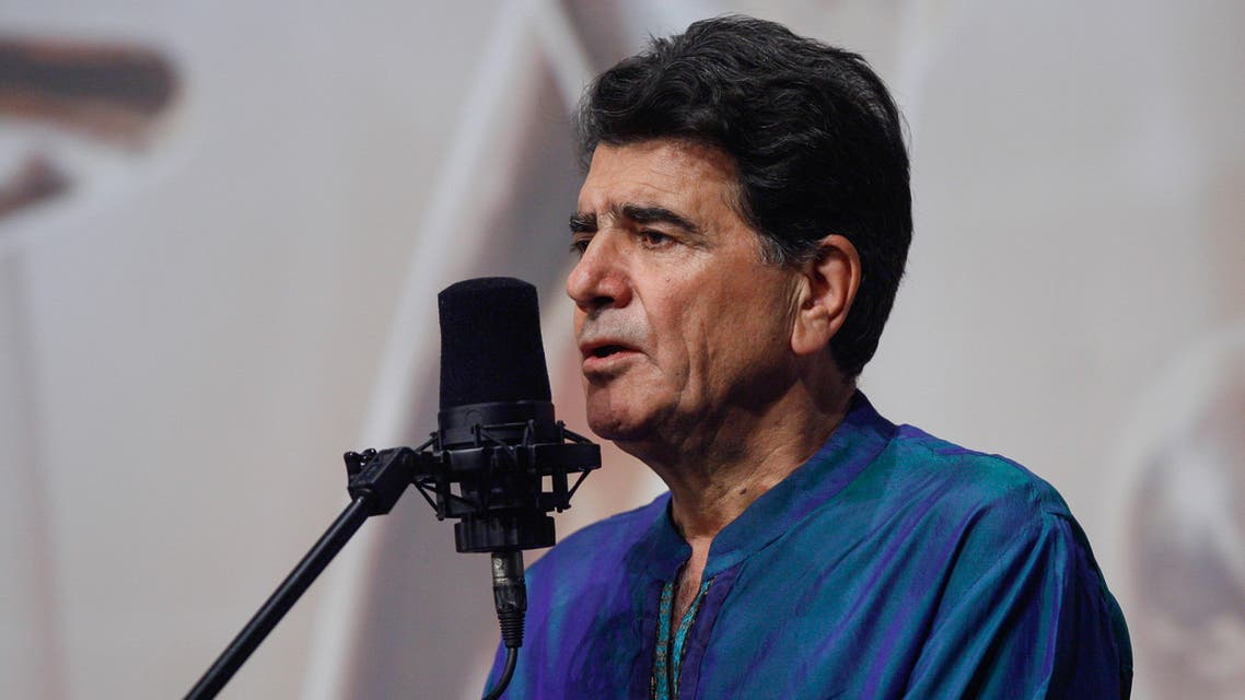 Iran's legendary singer, instrumentalist, and composer Mohammad-Reza Shajarian singing before a microphone in the capital Tehran. (AFP)
