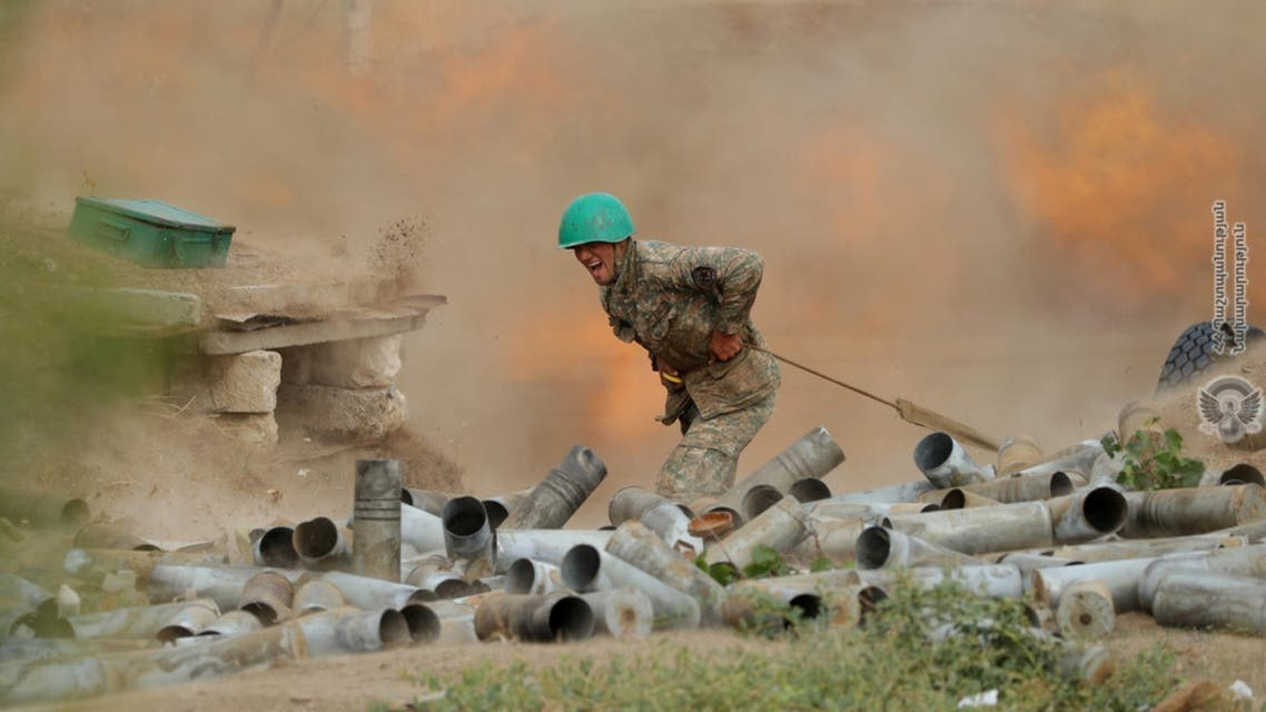 An ethnic Armenian soldier fires an artillery piece during fighting with Azerbaijan's forces in Nagorno-Karabakh. (Reuters)