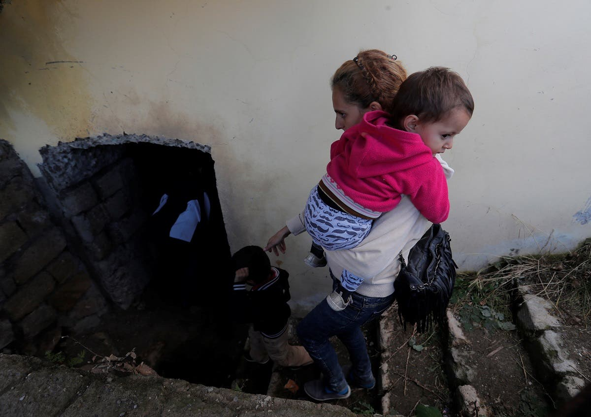 Local residents take shelter in the basement of a building during the fighting over the breakaway region of Nagorno-Karabakh, in Shushi. (Reuters)