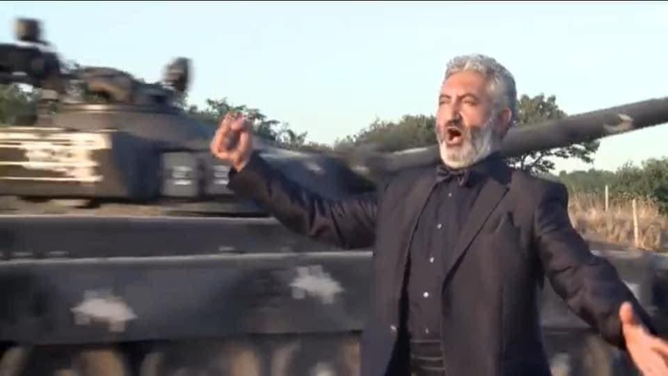 Lebanese-born Armenian opera singer Kevork Hadjian in front of a tank. (Facebook, Armenians in Lebanon)