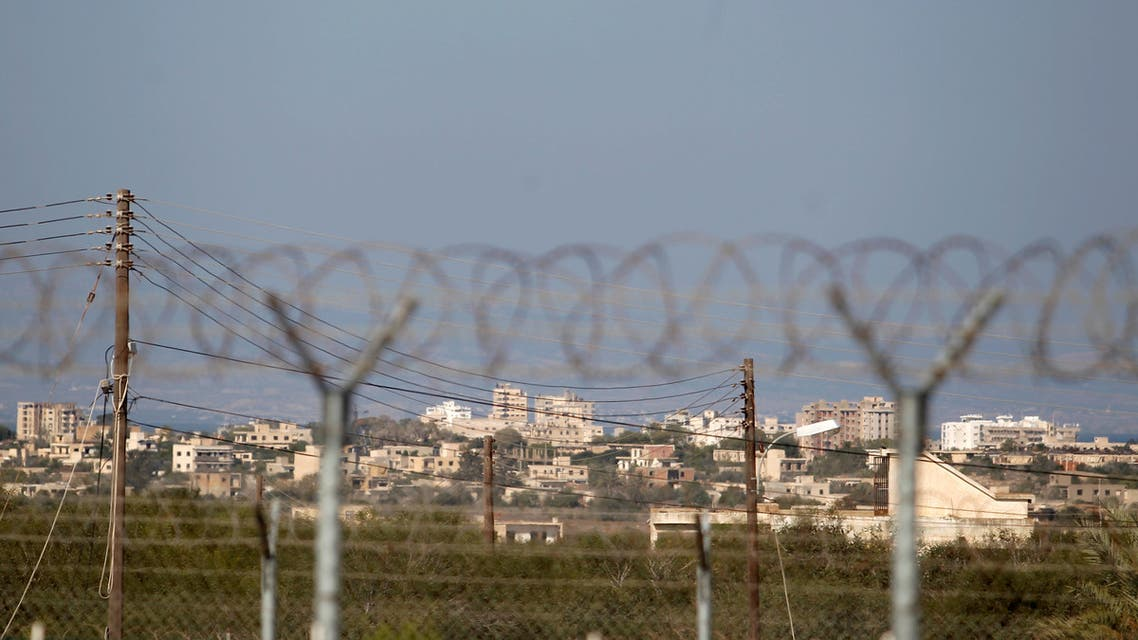 Fenced-in area of Varosha, restricted by the Turkish military is seen from Dherinia checkpoint. (Reuters)