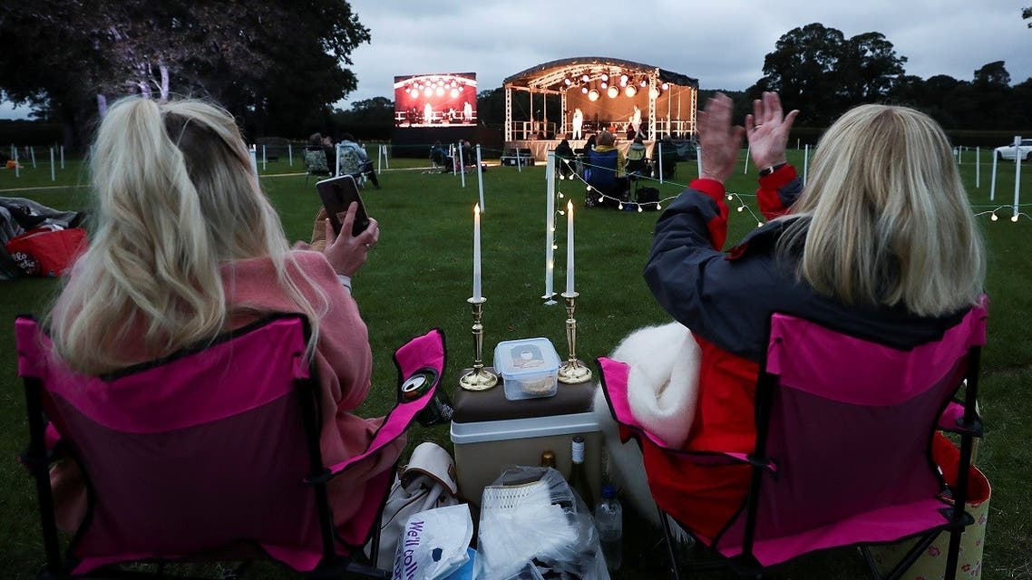 """Spectators keep social distance as they enjoy the outdoors theatre play """"Voices of The West End"""" at Bywell Hall, Northumberland, on September 19, 2020. (Reuters)_1178507669_RC2V1J93Q9M7_RTRMADP_3_HEALTH-CORONAVIRUS-BRITAIN"""
