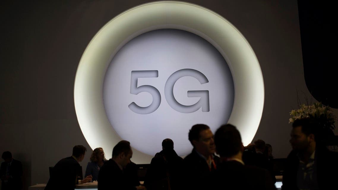 People stand next to a 5G logo during the Mobile World Congress wireless show, in Barcelona, Spain. (AP)