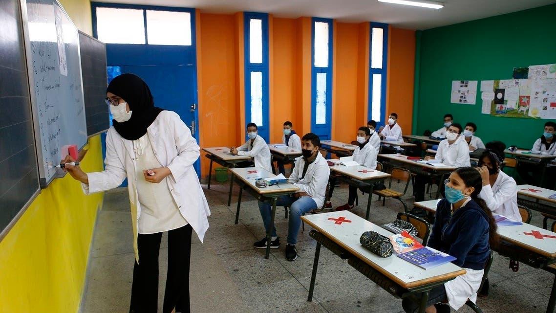 The teacher wears a face mask at Mansour Eddahbi College in the Derb El Kabir district of the AL Fida prefecture in Casablanca, Morocco. (AP)