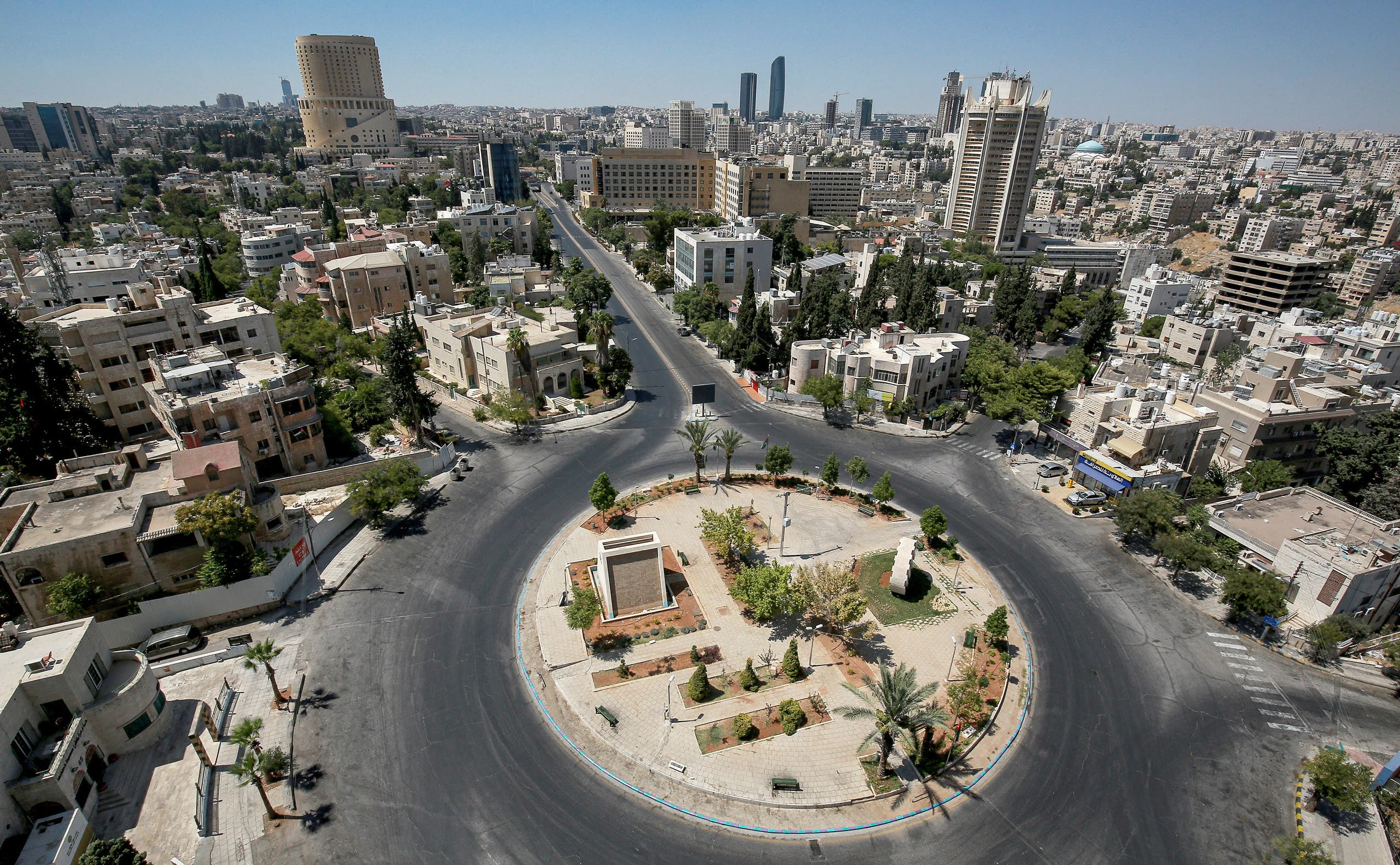 A view of an empty roundabout during a coronavirus pandemic curfew in the center of Jordan's capital Amman. (AFP)