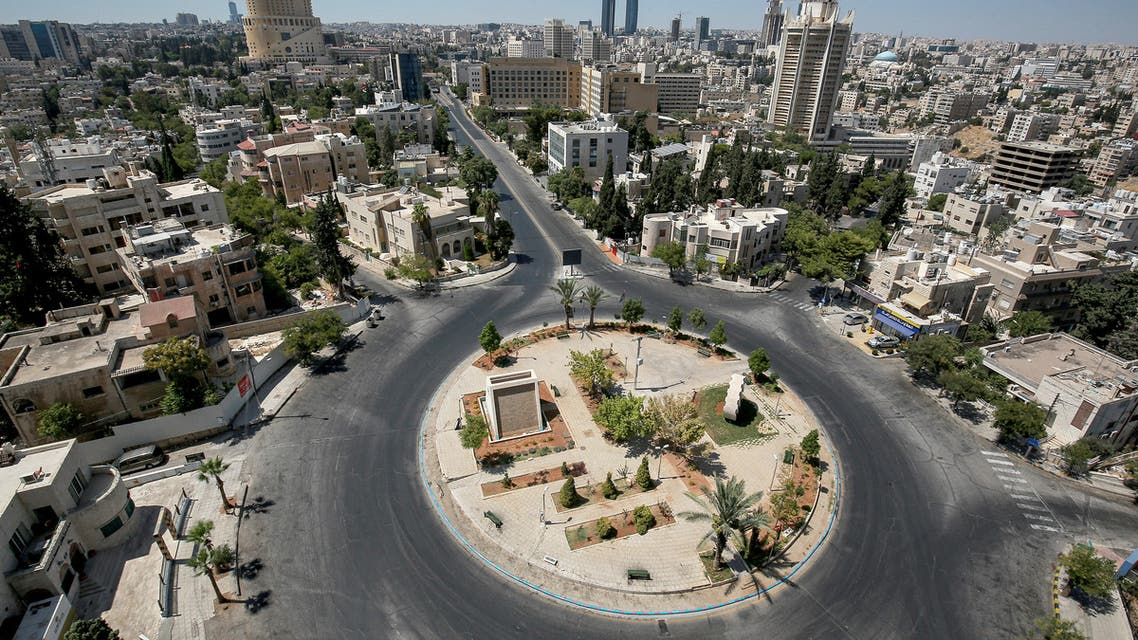 General view of an empty roundabout during a COVID-19 coronavirus pandemic curfew in the centre of Jordan's capital Amman. (AFP)