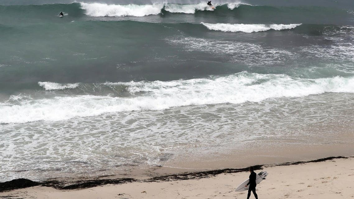 File photo of surfers taking to the water at Cottesloe beach in Perth, Australia. (AFP)
