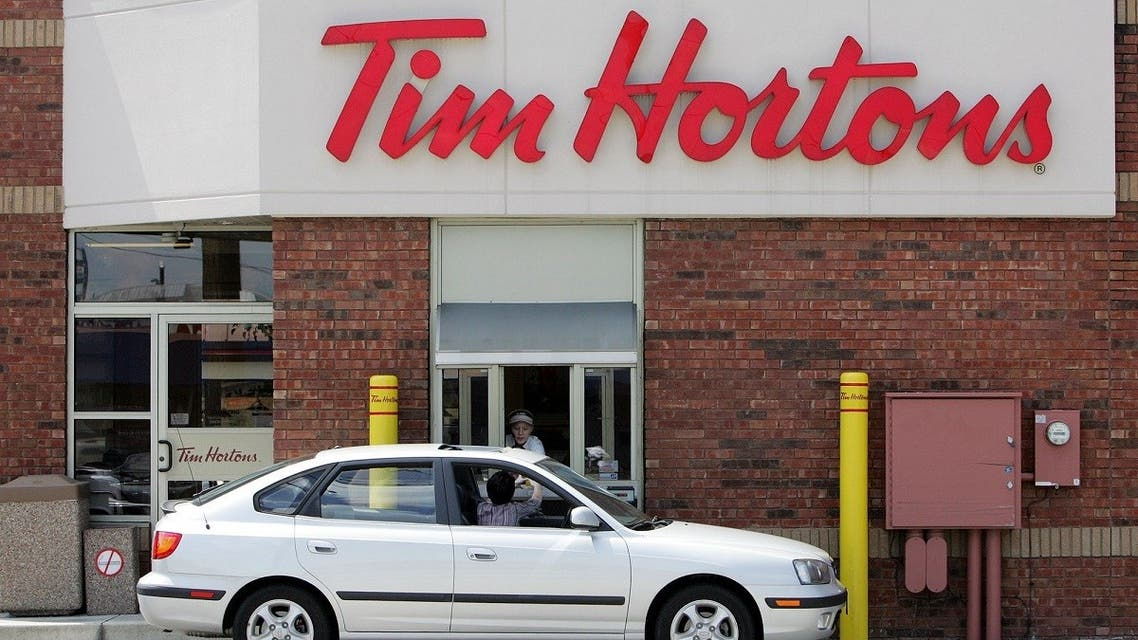 A Tim Hortons worker serves a drive-through customer at a Northwest side restaurant in Columbus, Ohio. (File photo: AP)