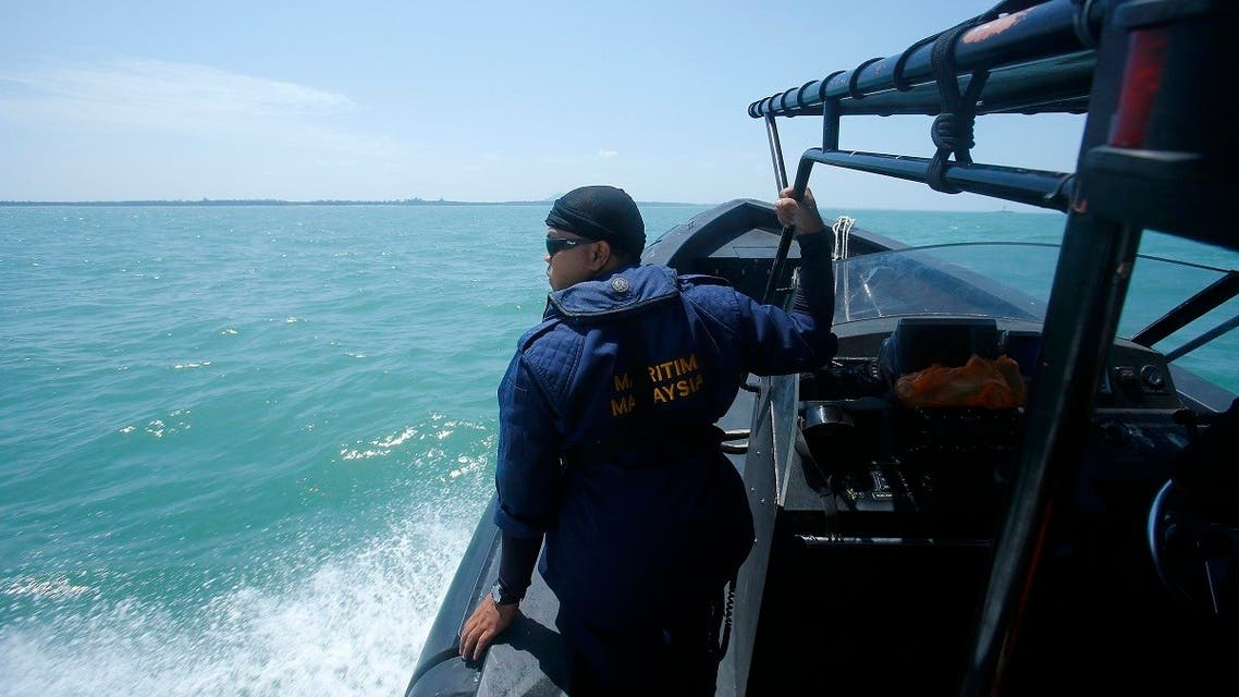 A Malaysia Maritime officer looks out into the sea during a search and rescue in Kuala Langat outside Kuala Lumpur, off Malaysia's western coast, June 18, 2014. (Reuters)