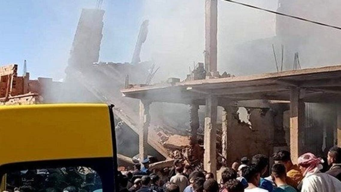 A photo posted by Algérie Presse Service on its Twitter account shows people gathered near buildings damaged by the gas blast in El Baydah on October 10, 2020. (Twitter/@APS_DZ)