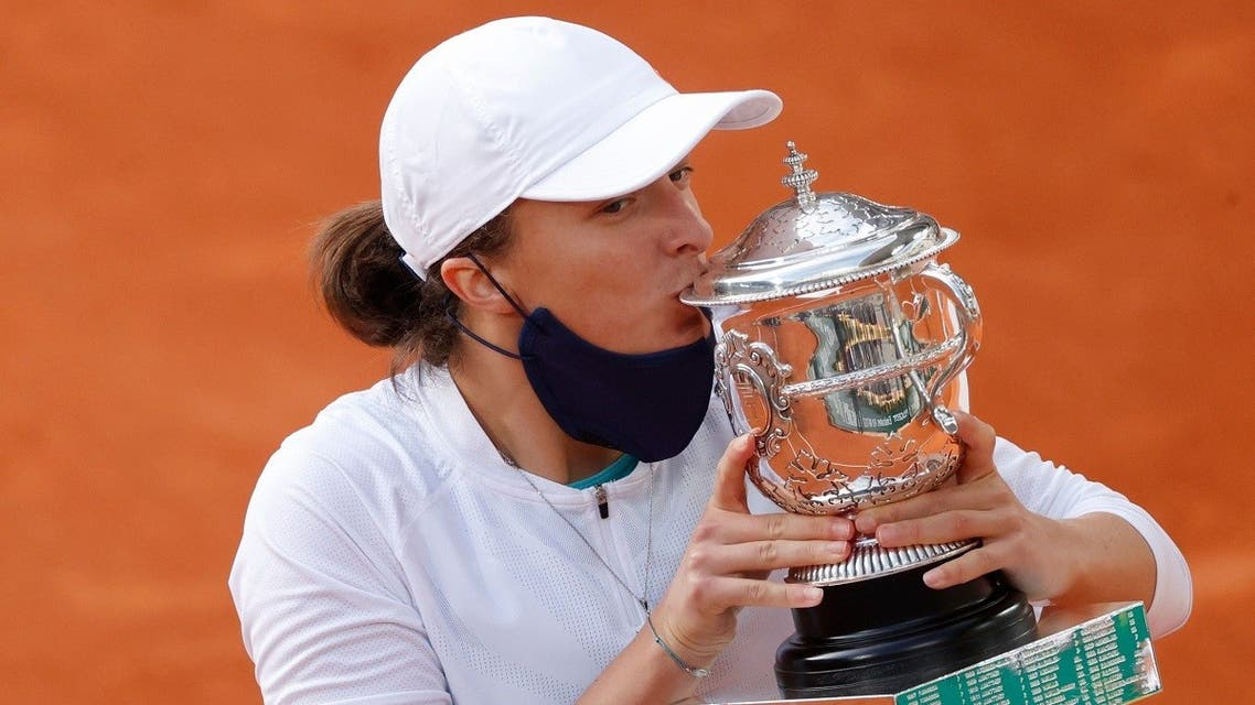 Poland's Iga Swiatek kisses the trophy as she celebrates after winning the French Open. (Reuters)