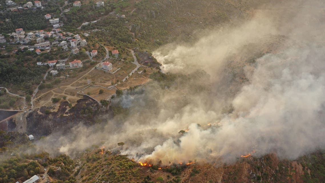 An aerial view shows smoke rising from a fire amid a heatwave in the Metn district of Mount Lebanon on October 9, 2020. AFP