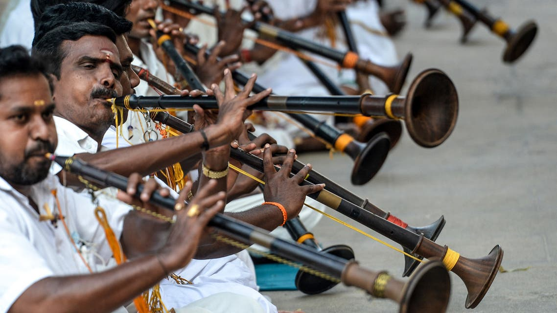 Musicians play the wind instruments called nadaswaram during a worship event to save people from the Covid-19 coronavirus in Chennai on October 9, 2020. (AFP)
