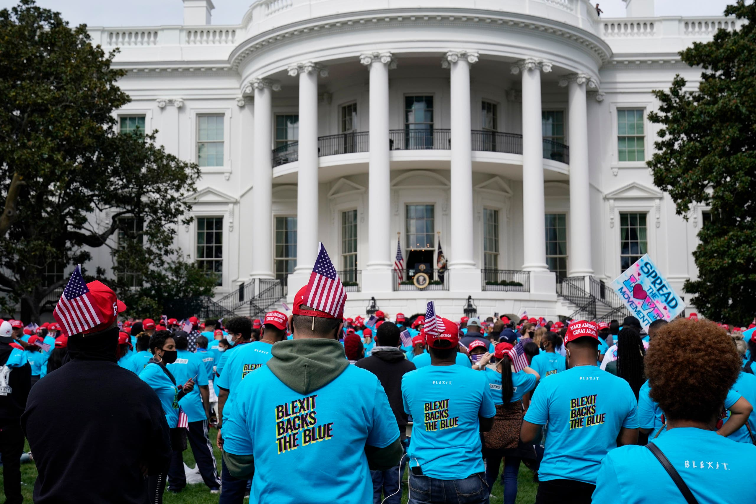 Supporters of President Donald Trump rally at The Ellipse, before entering to The White House, where Trump will hold an event on the South lawn on Saturday, Oct. 10, 2020, in Washington. (AP)