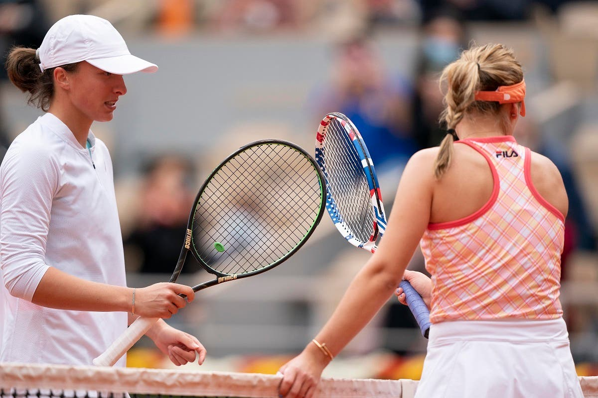 Iga Swiatek (POL) at the net with Sofia Kenin (USA) after their match on day 14 at Stade Roland Garros. (Susan Mullane/USA TODAY Sports)