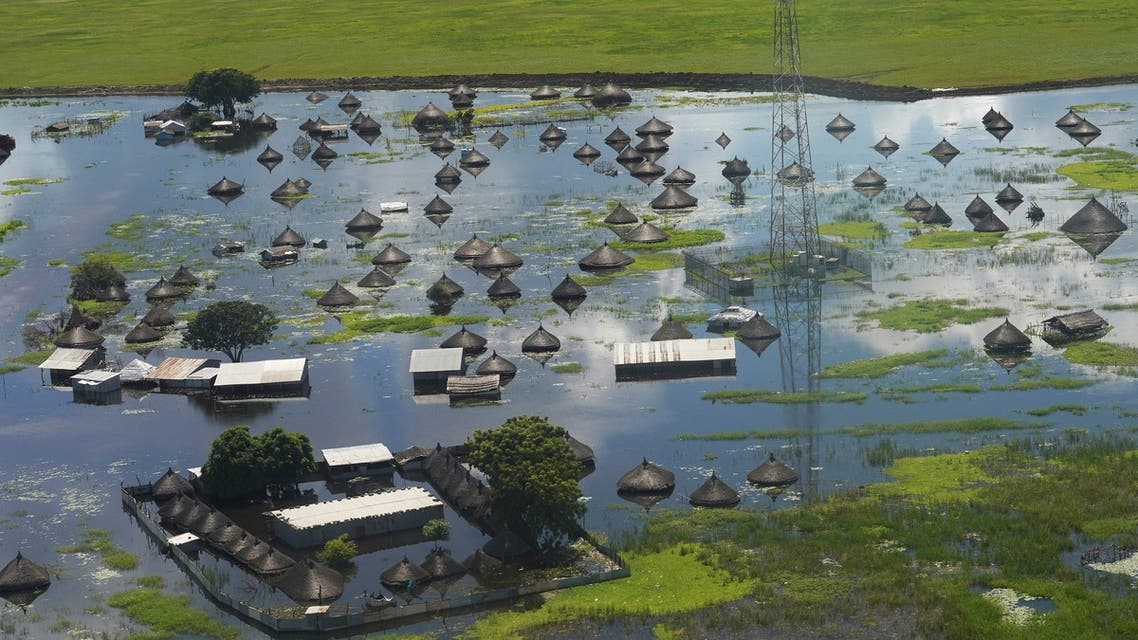 An aerial view shows flooded homes within a village after the River Nile broke the dykes in Jonglei State. (AFP)