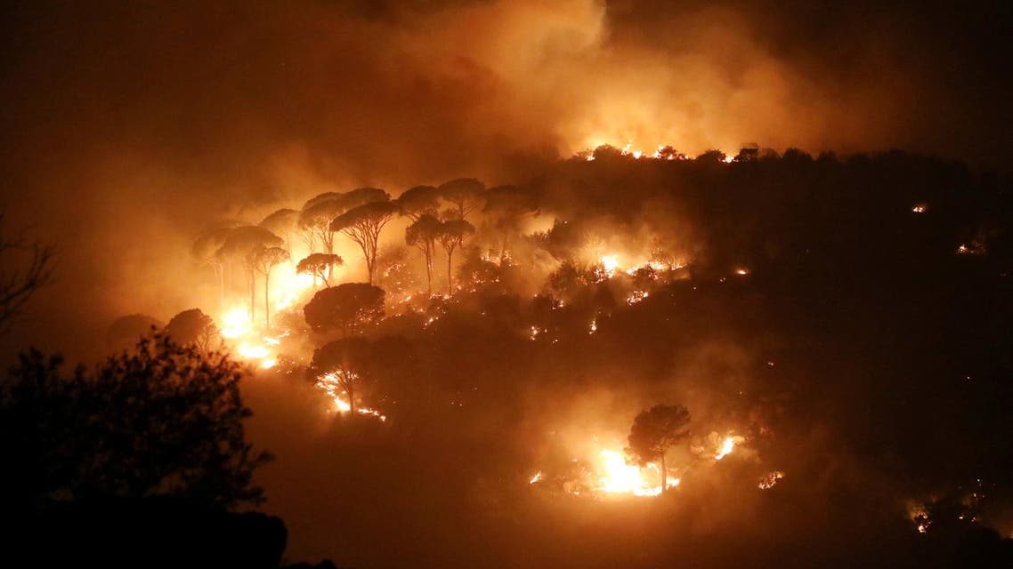 Wildfires burn a forest in Chbaniyeh village, Lebanon October 9, 2020. Picture taken October 9, 2020. REUTERS/Mohamed Azakir TPX IMAGES OF THE DAY