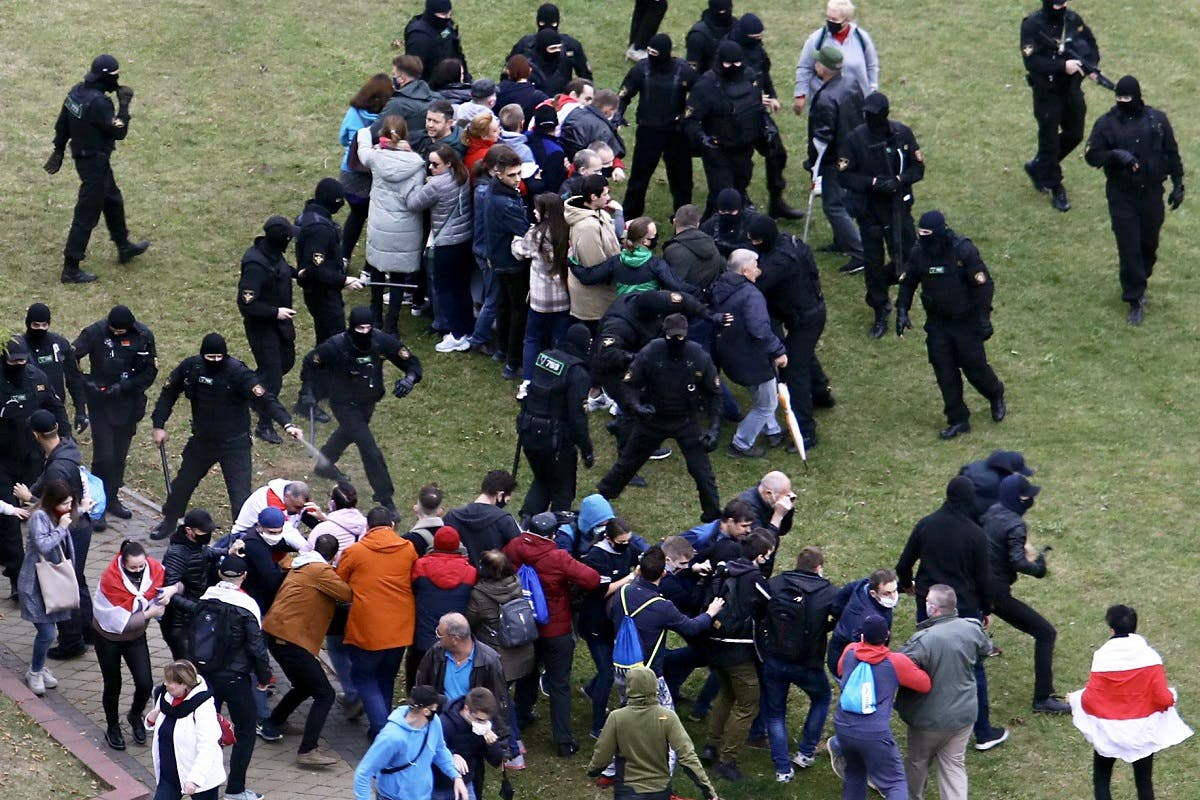 Law enforcement officers scuffle with demonstrators during a rally to protest against the Belarus presidential election results in Minsk on October 11, 2020. (AFP)