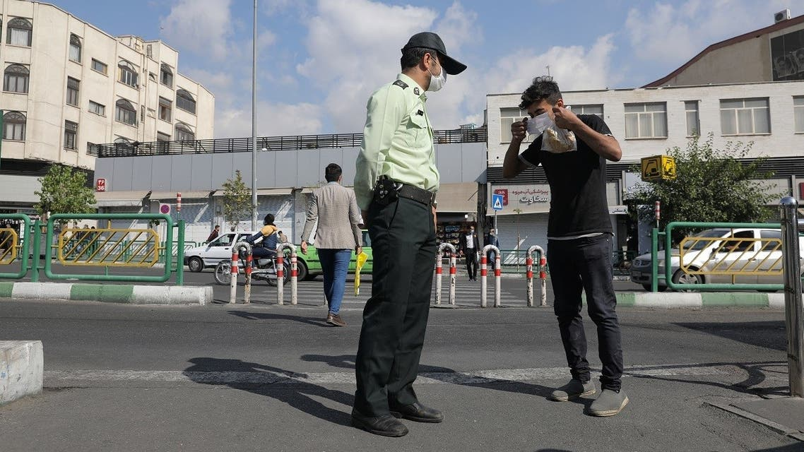 A police officer advises an Iranian man to wear a face mask after Iranian authorities made it mandatory for all to wear face masks in public following the outbreak of the coronavirus disease (COVID19), in Tehran. (Reuters)