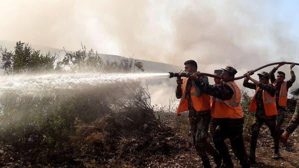 شاهد.. لحظة انهيار مبنى بشركة التبغ بسبب حرائق سوريا
