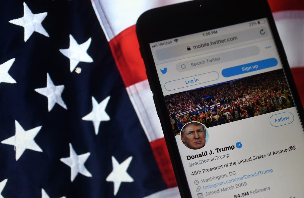 In this photo illustration, the Twitter account of US President Donald Trump is displayed on a mobile phone on August 10, 2020, in Arlington, Virginia. (AFP)